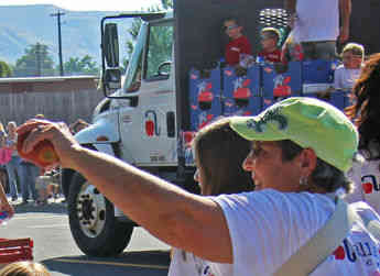 An Allan Brothers truck load of packed apples are handed out to the community at a Yakima Valley event.